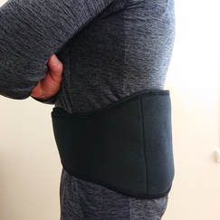 Back and body belt around low back. View from the side.